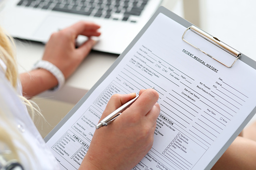 Assistant filing patient forms